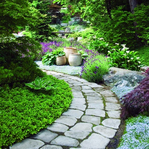 The use of hard surfaces and stones in garden design for Garden path